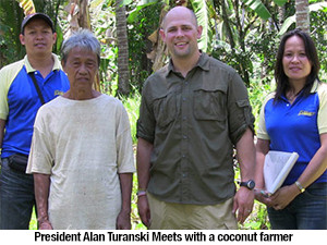 GloryBee President Alan Turanski meets with a fair trade coconut farmer