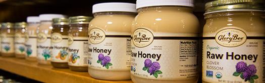Shelf of GloryBee Honey